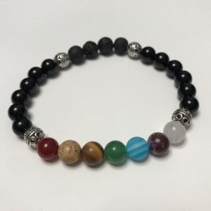 bracelet with beads representing the 7 chakras and black lavastone