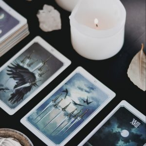 tarot spread with burning white candle