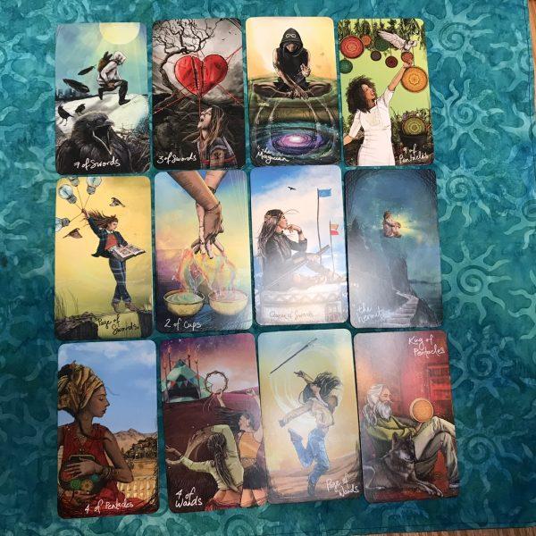 12 card tarot layout featuring cards from ThevLight Seer's Tarot