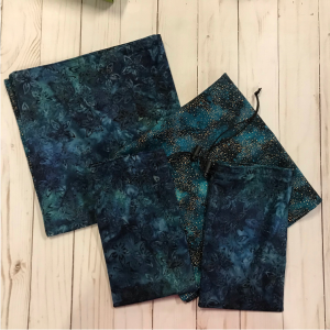 drawstring bags and reading cloths made from navy floral batik fabric