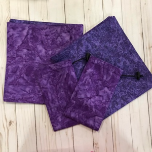 drawstring bags and reading cloths made from purple batik fabric