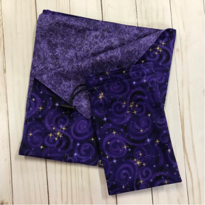 drawstring bag and reading cloth made from purple swirl cloth with gold stars and a sparkly purple lining
