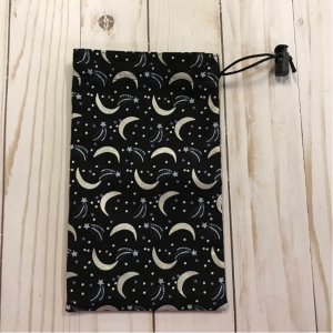drawstring bag made from fabric featuring moons and shooting stars